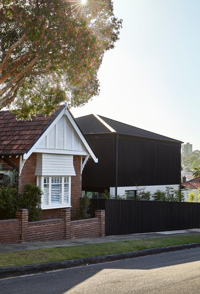 There is a clear dichotomy and demarcation between the Federation home and the new charred-timber extension.