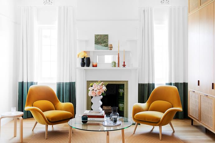 """**BEST USE OF COLOUR - Sponsored by Porter's Paints**<br> **EVA-MARIE PRINEAS OF STUDIO PRINEAS**<br> The original features of this character-rich California bungalow in Sydney's inner west were hugely inspiring for architect Eva-Marie. The colour of the fire surround became a springboard for the palette used in this space, the home's formal sitting room. Its pale oak floors and white walls create a crisp background for the room's vibrant mustard chairs and two-tone curtains, which playfully align with the ornate sills of the bungalow's windows. """"The lovely colours in the fire surround drove the tactile, layered sensibility,"""" says Eva-Marie. """"Our goal was to evoke the nostalgia of the home's heritage while allowing for the practicalities of contemporary living."""""""