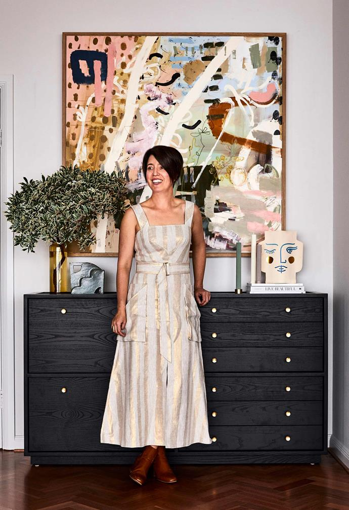 """**Living room** """"I do love white,"""" says Josie, pictured in front of a Crate storage unit from [Trit House](https://www.trithouse.com.au/