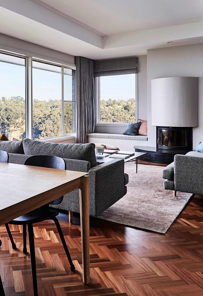 """**Living room** Next to the revamped fireplace is a bench seat stretching across a space that was once wasted on firewood. The walls are [Dulux](https://www.dulux.com.au/