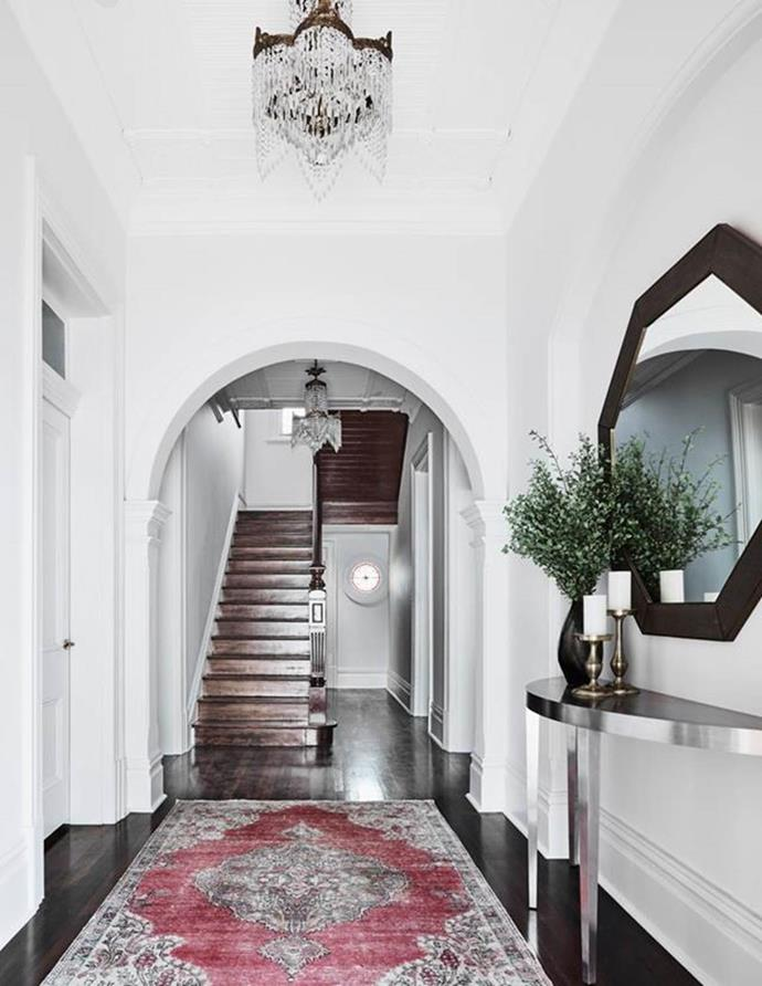 """A vintage rug creates a beautiful, homely welcome in this [stately mansion](https://www.homestolove.com.au/stately-mansion-interior-makeover-21592