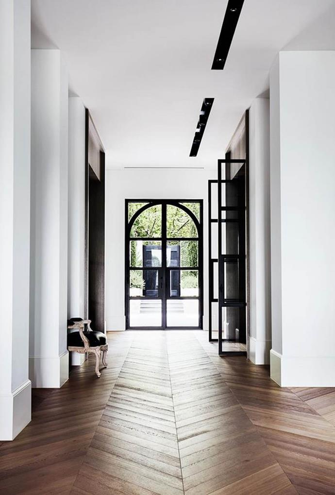 """A muted palette of alternating black and white rooms lends a pleasing rhythm to this stylishly [understated house](https://www.homestolove.com.au/melbourne-home-with-french-and-belgian-influence-6435
