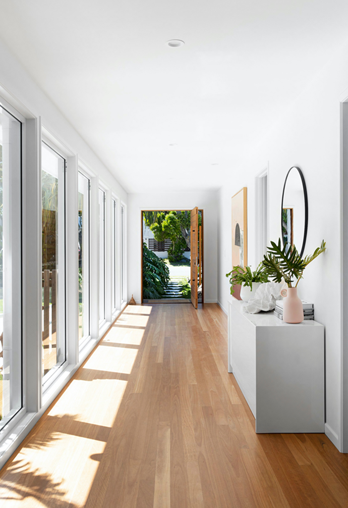 "Blackbutt timber floorboards line the hallway overlooking the pool in this [family abode](https://www.homestolove.com.au/coastal-home-northern-nsw-22199|target=""_blank"") in coastal northern NSW. Floor-to-ceiling windows flood light into the lengthy space."