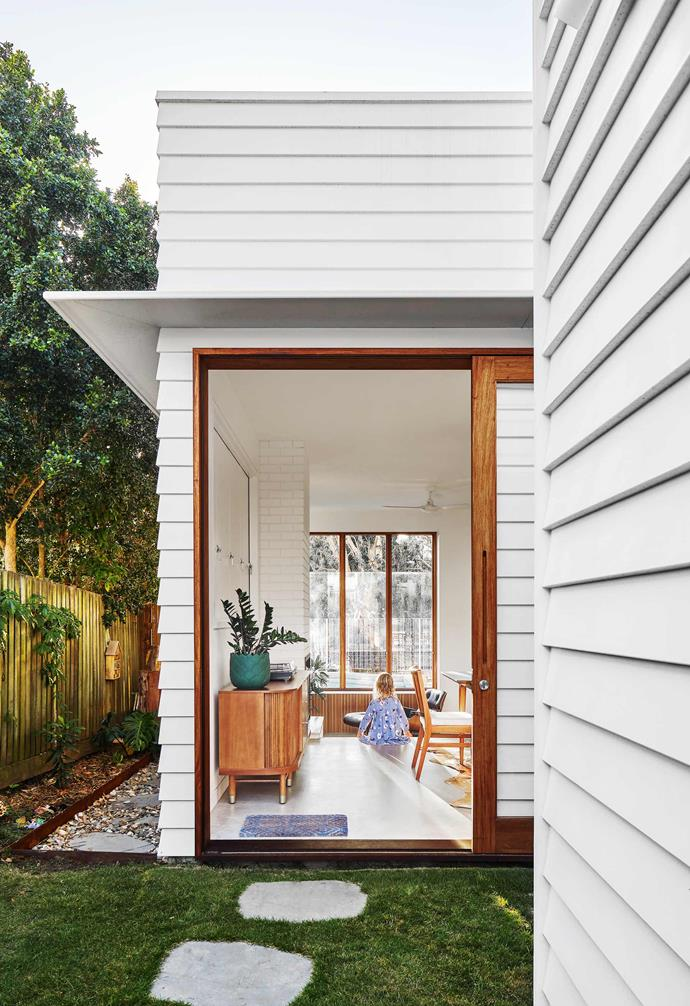 **Garden** A sliding door leading off the dining room provides access to a shaded patch of lawn that has quickly become an afternoon play spot for the kids.