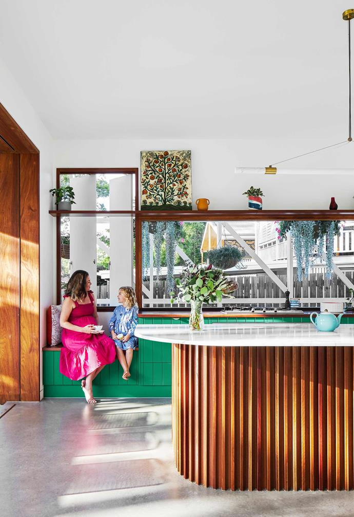 """**Kitchen** The base of the bespoke island is spotted gum and the countertop is Carrara marble. Charlie painted the joinery a [Dulux](https://www.dulux.com.au/