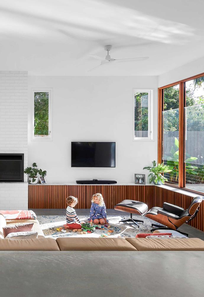 **Living/dining** A modular sofa from Janda and an Eames chair were chosen for the sunken lounge area.