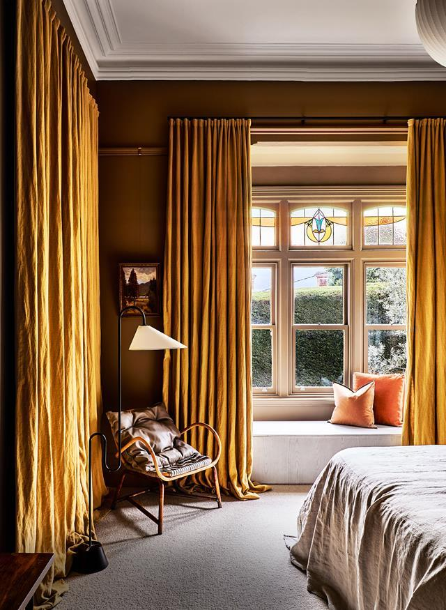 """Rich marigold hues in the master bedroom of this updated [single-storey 1900s Queen Anne property](https://www.homestolove.com.au/updated-1900s-queen-anne-property-22072