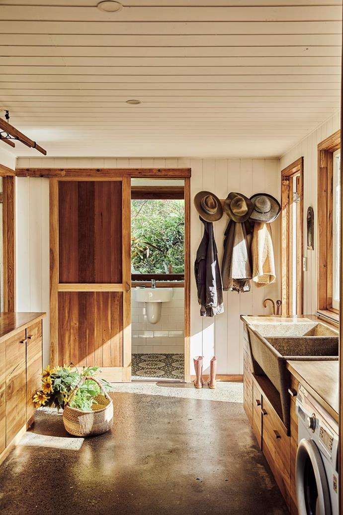 "A reclaimed concrete trough features in the timber-filled, farmhouse-style laundry of this [multi-generational family home](https://www.homestolove.com.au/recycled-timber-home-sustainable-21272|target=""_blank"") built from sustainable and recycled timbers in the hinterland of Balina."