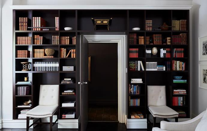 """Custom-joinery and contrasting blank and white paint creates a clever use of space in this small apartment and makes for a magnificent home library in the stylish 19th century home-away-from-[home of interior designer Cameron Kimber in Sydney](https://www.homestolove.com.au/a-19th-century-pied-a-terre-in-sydney-4928