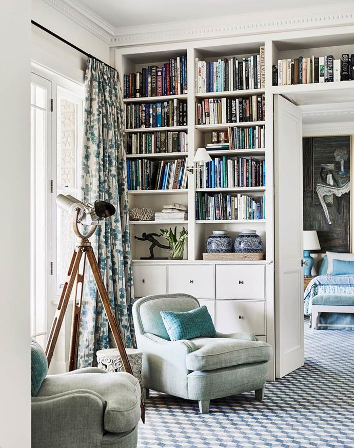 """The cosy reading nook next to a built-in library shelves in this [cliff-side beach house](https://www.homestolove.com.au/clifftop-beach-house-hamptons-style-19414