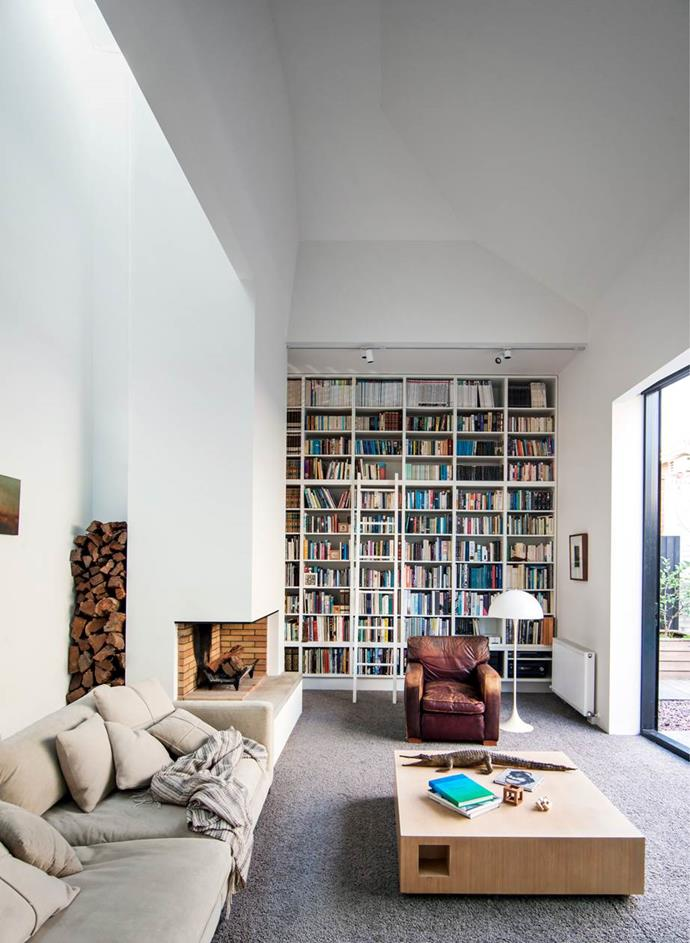 A wall of books sets the tone for quiet time in the library which doubles as a parents' retreat in this Melbourne home by Coy Yiontis Architects and Rosa Coy.