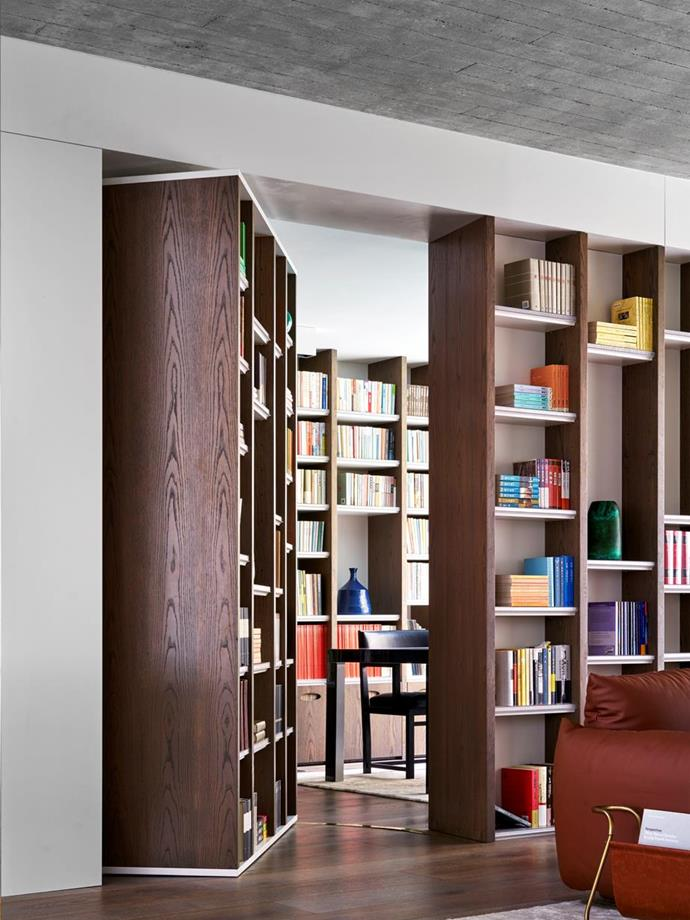 """Architect Luigi Rosselli calls this the 'Anne Frank' bookcase as the pivoting door conceals the owner's study, providing a quiet, tranquil space in the [epic stacked house](https://www.homestolove.com.au/a-stacked-house-in-harmony-with-its-cliff-side-location-6943