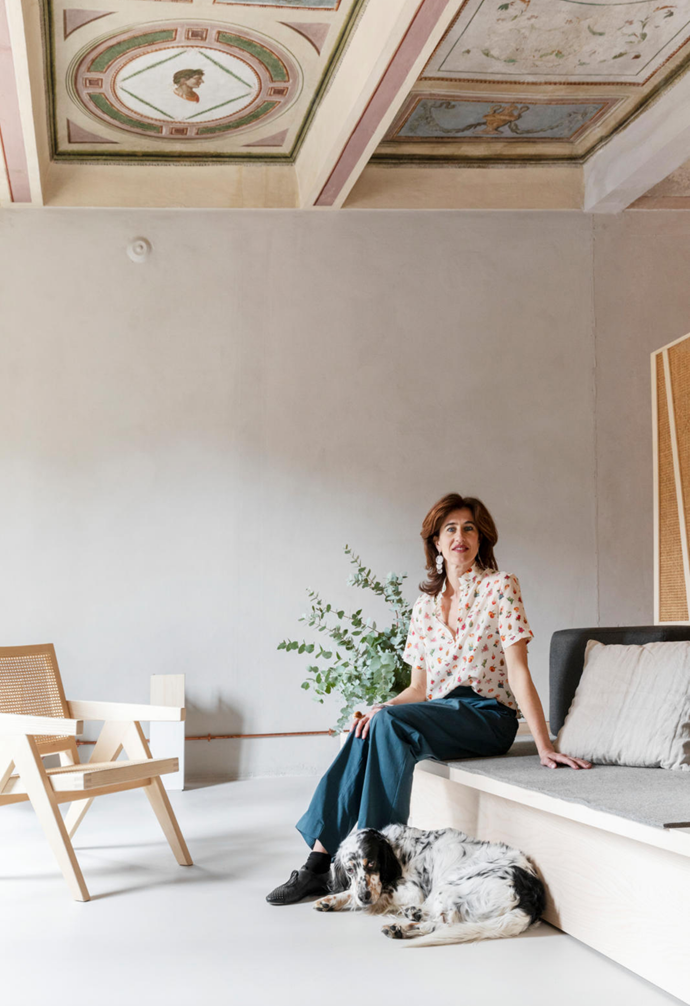 "Sara, pictured, sits on pale ash and birchwood furniture replete with rattan detailing in the living area, where subtle notes of colour are injected in the form of decorative objects and homewares. ""The furniture is both crude yet refined and establishes a hybrid relationship within the space,"" Diego says"