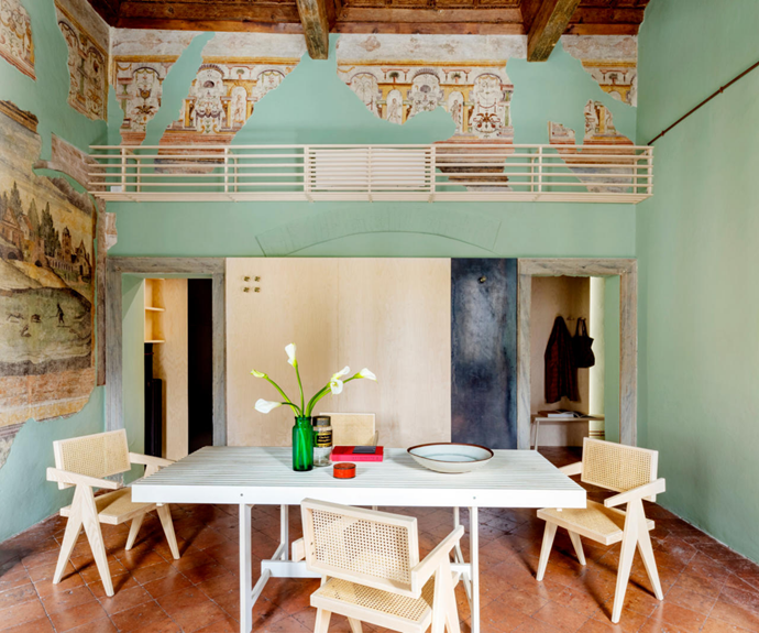 Diego Cisi and Stefano Gorni Silvestrini of Italian architecture firm Archiplan Studio were tasked with transforming this historic apartment into a contemporary home. Their solution? An elegant yet practical renovation that fuses old-world decoration with modern minimalism. You can see this at work in the dining room's green walls, which tie in perfectly with tones in the existing frescoes.