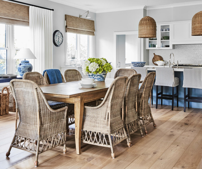 """""""I'm a mad blue-and-white person,"""" says homeowner Judy. In the dining area of her and Mike's beautiful home in Bowral, NSW, bold blues are tempered by the natural textures of 'Urban Weave' blinds from Blinds by Peter Meyer, French Country 'Costello' dining chairs and an Alliance Furniture dining table, all from The Classic Outfitter, and Pottery Barn baskets."""