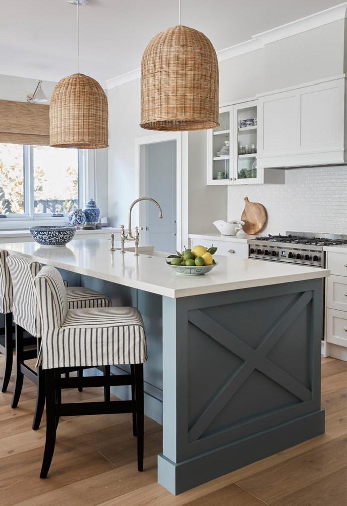 The Perrin & Rowe 'Ionian' bench-mounted mixer is from The English Tapware Company, and the rattan pendant lights were there when Judy and Mike bought the home.