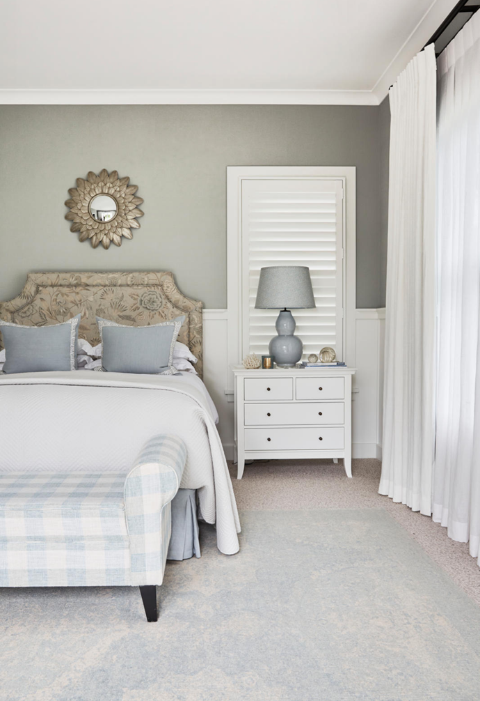 The main bedroom has a softer palette, with a custom ottoman in Warwick Fabrics 'Arlington' plaid in Duckegg, a bedhead in Thibaut 'Cleo' linen in Spa Blue and a gourd lamp, all by The Classic Outfitter. The mirror is from Pigott's Store and the 'Hampton' chest from Xavier Furniture.