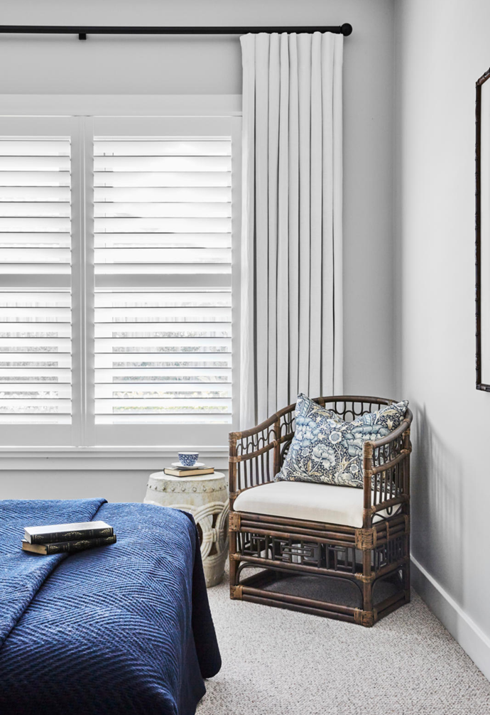In the guest bedroom, a 'Temple' rattan chair from Xavier Furniture guarantees a cosy nook to relax or read.