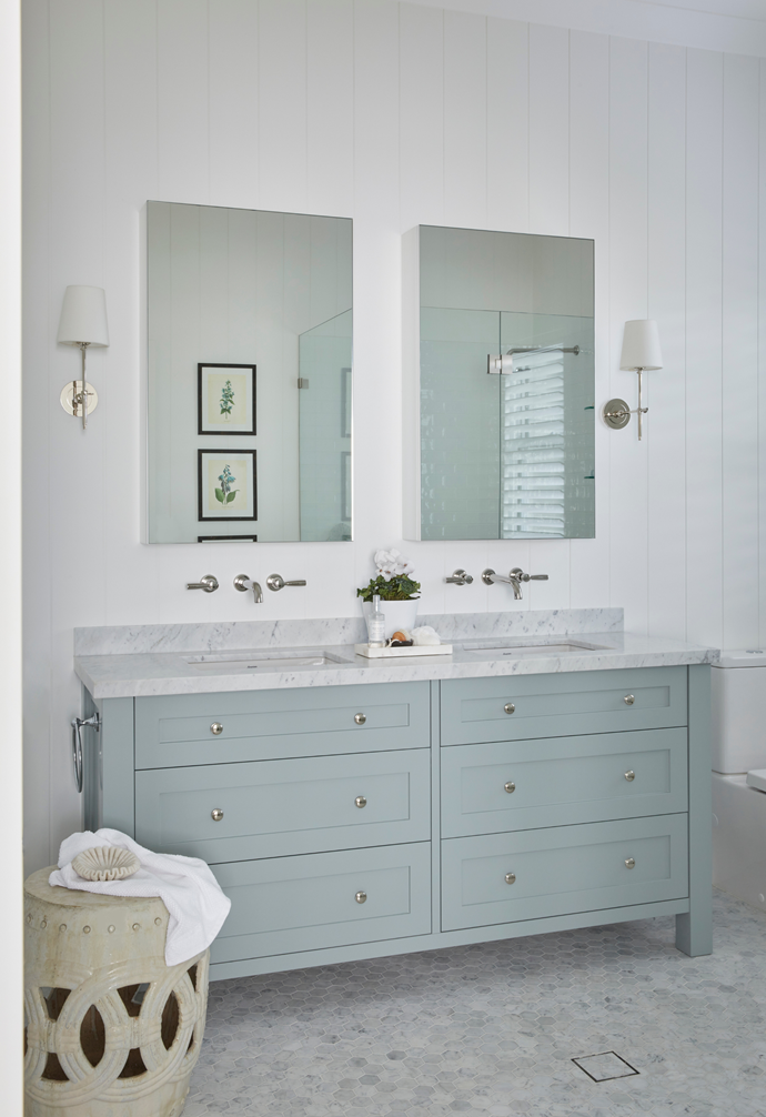 """Judy and Mike's serene ensuite remains almost as they found it, with a Carrara marble-topped vanity painted in Evic Thundercloud and honed Carrara marble mosaic floor tiles to match. """"The colours are very peaceful but also gender neutral, which is ideal for an ensuite,"""" said Georgia."""