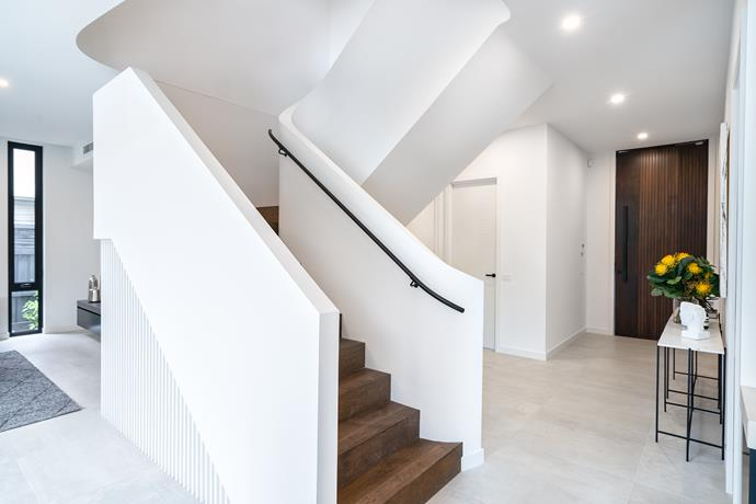 A design focus is the sculptural staircase, which was inspired by the elegance of a swan's neck.