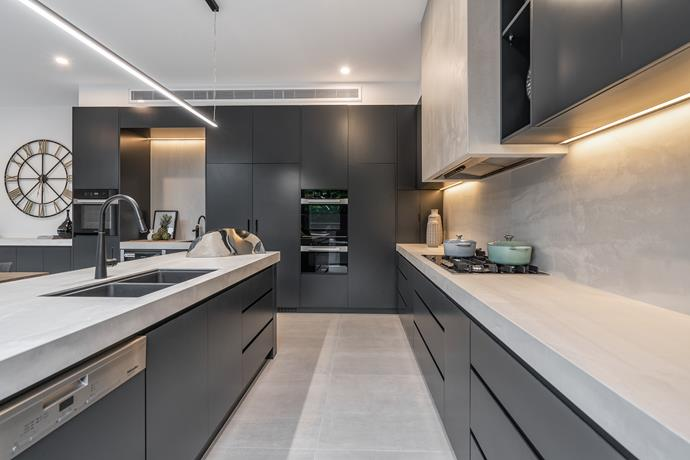 Sleek and minimalist, the kitchen is fitted with state of the art integrated appliances, including Miele cooktops and a Vintec wine fridge.