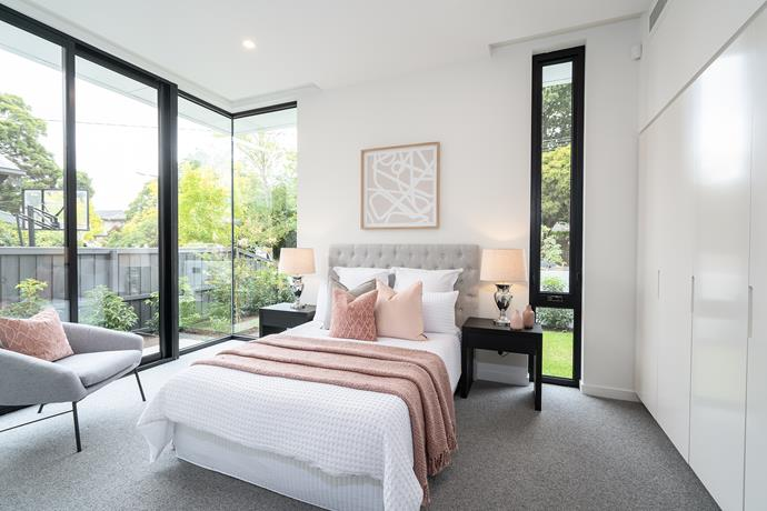 The bedrooms are filled with with natural light and views of outdoor greenery.