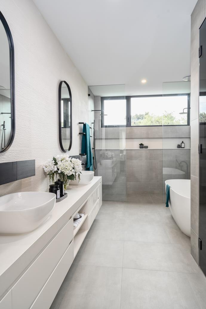 The bathrooms feature minimalist fixtures and complementary grey and white textures.