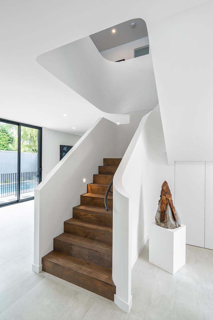 The entrance of the property affords plenty of natural light, as residents are greeted with the impressive staircase as the home's pièce de résistance.