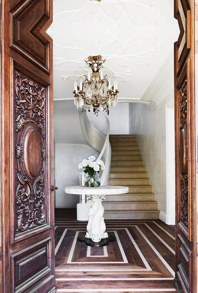 Intricately carved 19th century oak doors create an enchanted entry point into this five-bedroom Italianate mansion on Sydney's harbourside.