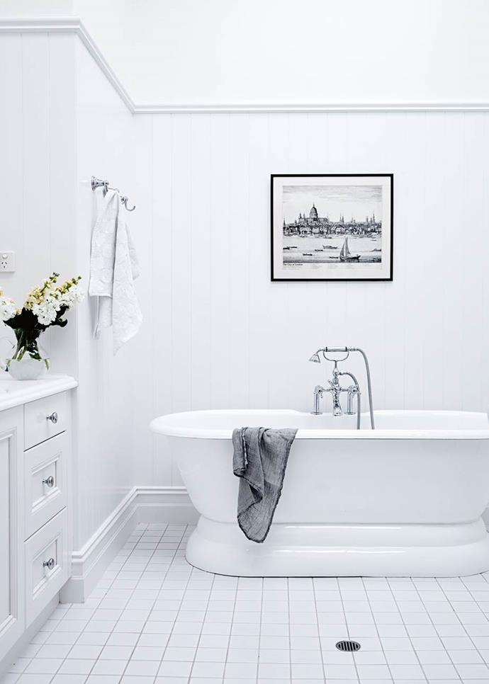 "White walls and floors light up the classic English-style bathroom with a Hamptons-aesthetic in the [classic contemporary restoration of a historic homestead](https://www.homestolove.com.au/classic-contemporary-homestead-13411|target=""_blank"") in the Adelaide Hills."