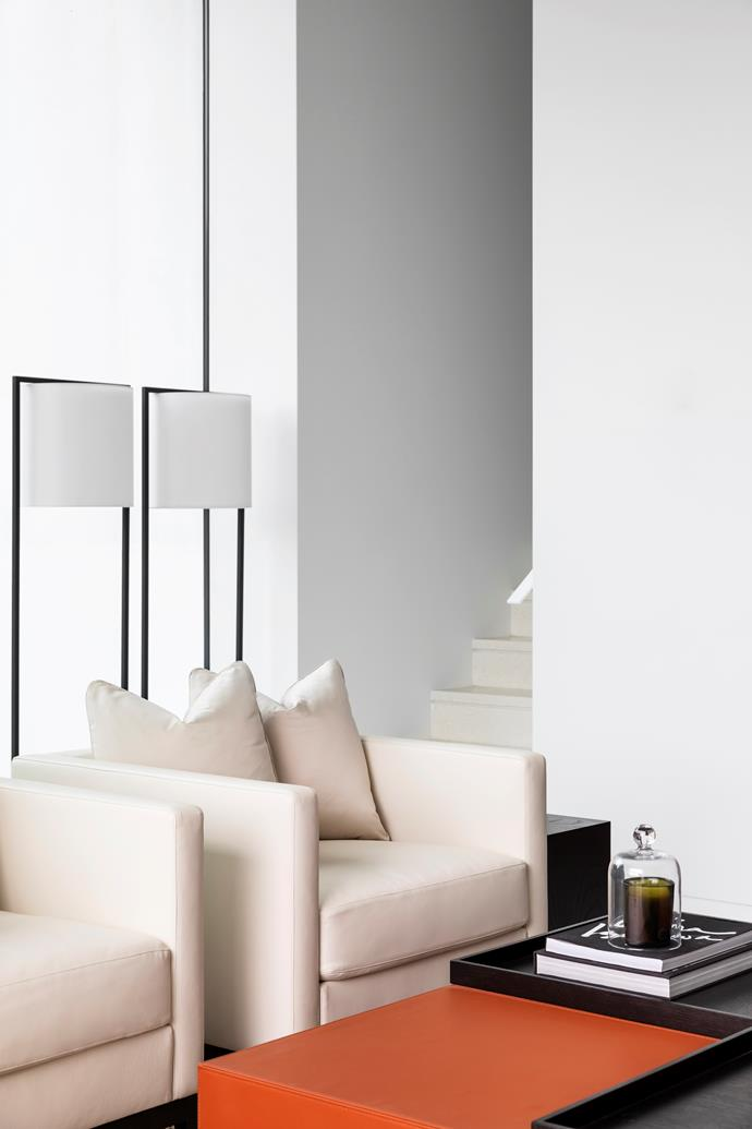 The lower-ground living and bar area boasts four metre-high ceilings and features a Christian Liaigre coffee table and leather armchairs and Kevin Reilly lamps from Holly Hunt.