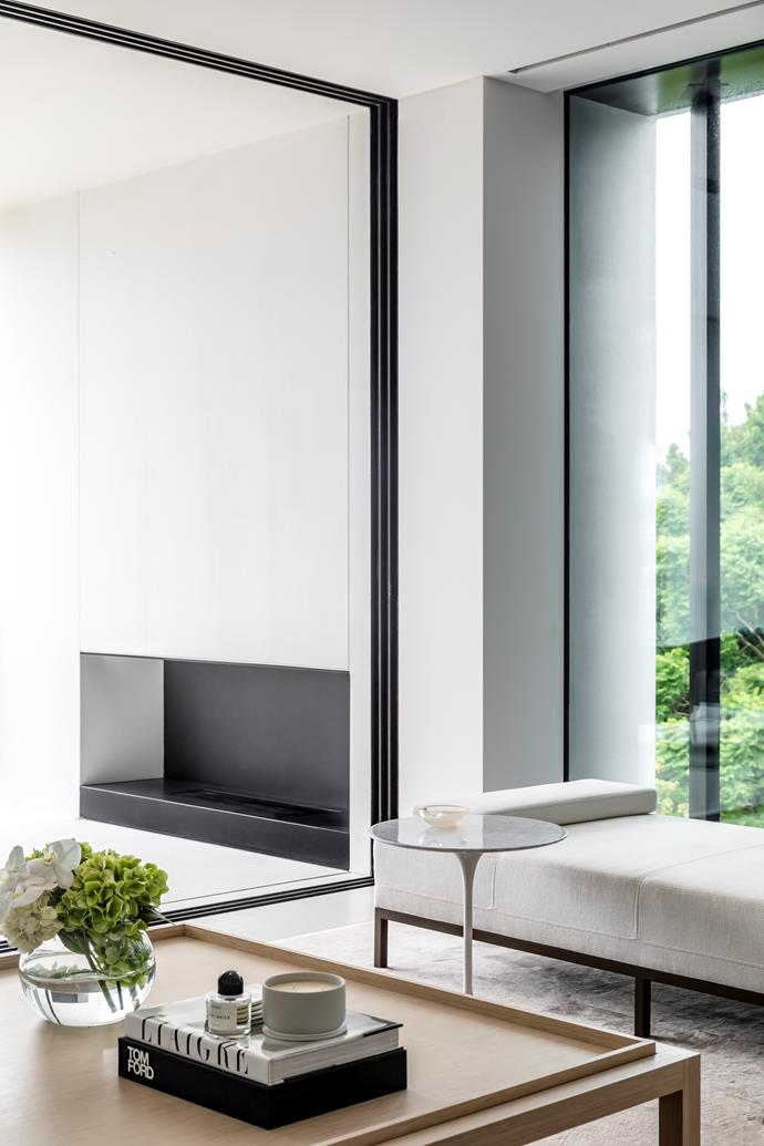 The coffee table in this upstairs living room is a custom piece. When the glass Vitrocsa doors are open the interior and balcony form one fluid space.