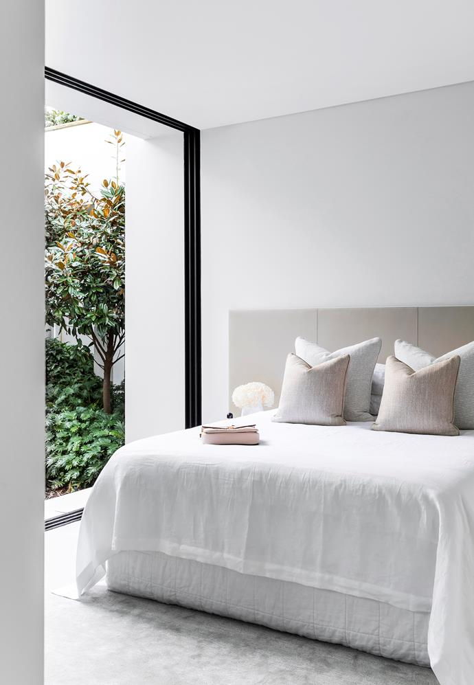 The guest bedroom faces a private garden designed by William Dangar. The custom bedhead is in Pelle 'Vienna' leather with saddle-stitch detailing and a metal border. The Society Limonta bedding is from Ondene and the cushions are in Dedar Milano and Brochier fabrics.
