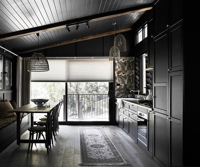 Decidedly different from typical white coastal homes, the rich, dark colour palette makes a bold style statement.