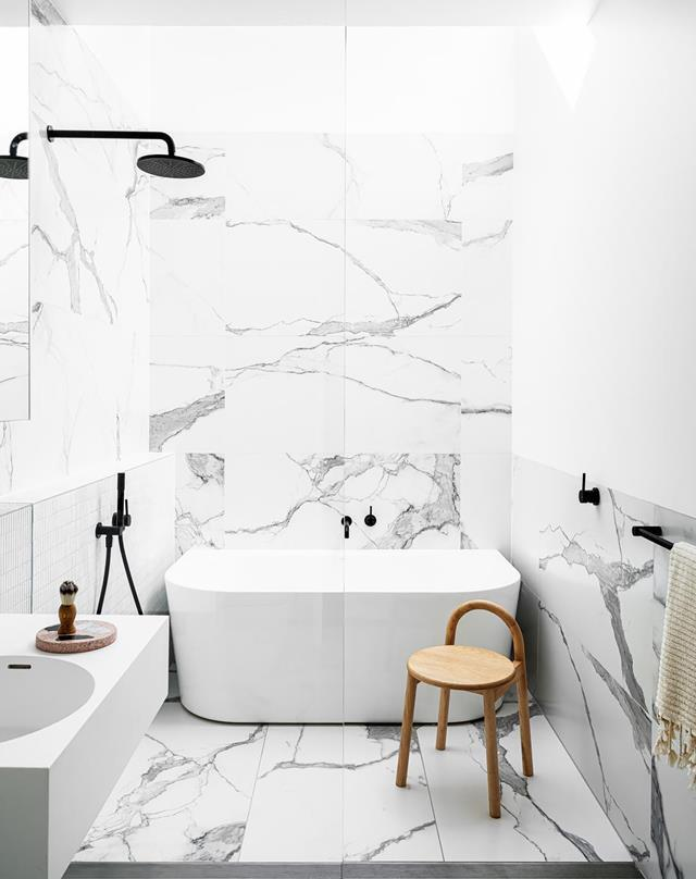 "A walk-in shower is an easy way to transform your bathroom no matter how big or small your space, and is the perfect addition to any modern bathroom. Although it sits in the centre of this [sophisticated monochrome space](https://www.homestolove.com.au/architects-cleverly-renovated-family-home-21870|target=""_blank"") conceived by Carla Middleton, the shower is almost hidden."