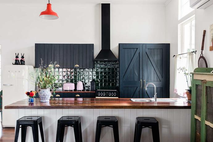 Caitlyn and Sam painted the existing kitchen cupboards and added a timber marine-varnished benchtop (sourced from a horse stable), while the pendants were purchased at Lunatiques in Sydney.