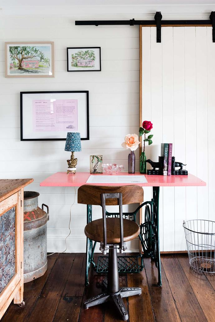 Top left artwork is by Brett Danvers and top right is by Eliza McNamee. Below them is the store history and an illustration by Georgia Draws A House, hanging above an antique Singer chair and table.