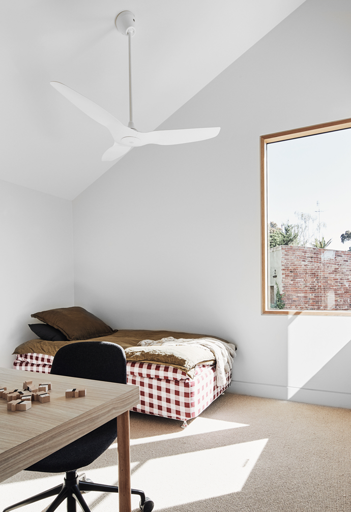 """""""The bedrooms are small in footprint to achieve the void/double-height space, they have built-in robes and desks and tall angled ceilings to allow the proportions of the room to feel generous,"""" said the owner of this [sun-filled Melbourne terrace](https://www.homestolove.com.au/modern-terrace-extension-melbourne-22221