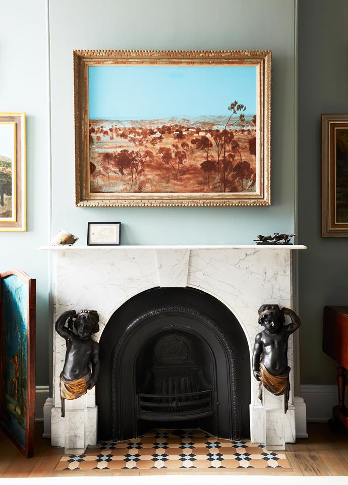 Flanked by bronze sculptures from a Paris antiques dealer, the fireplace hearth was finished in tiles sourced by design consultant Wende Reid of Form and Colour to match the original front hallway. Artwork by Ray Crooke.
