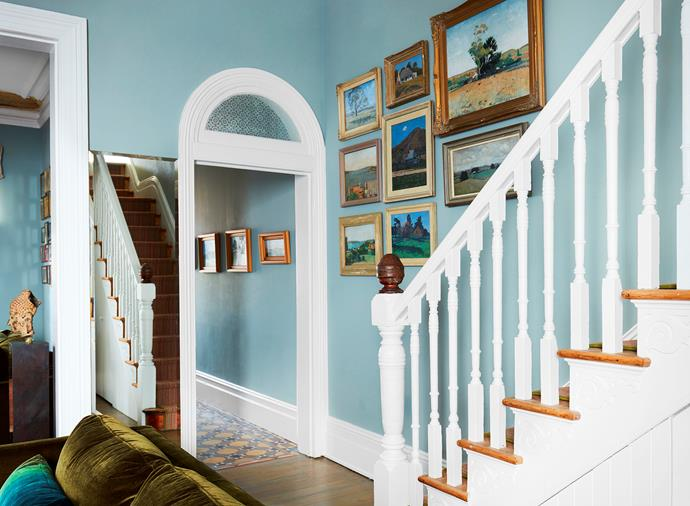 Exhibited salon style at the bottom of the stairs and continuing along the front hallway is a series of paintings by Susanna's grandfather, Sir Charles Lloyd Jones.