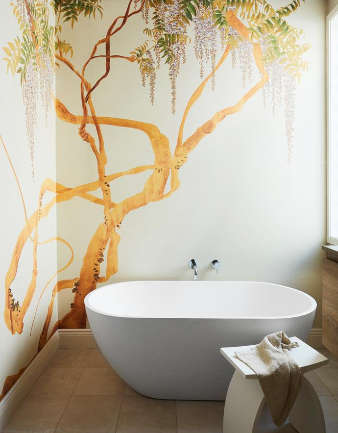 In the bathroom, the Iksel 'Edo Wisteria' wallpaper from Boyac creates a sublime backdrop to the bath from ACS Designer Bathrooms in Woolla