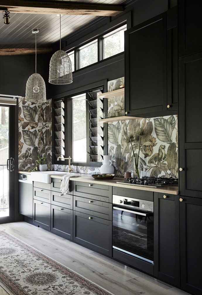 """A galley layout is ideal in the compact kitchen zone, with Ikea cabinetry hugging a wall defined with striking Tropical Bird tiles from Tiles by Kate. A [Bosch](https://www.bosch-home.com.au/