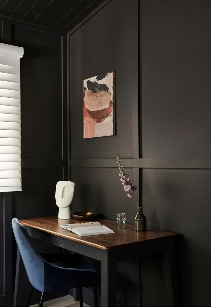 For added functionality, a corner of the main bedroom is a devoted study nook, elegantly furnished with a desk and a Midnight Velvet 'Sofie' chair from Early Settler. An added benefit of dark walls, particularly in a rental property, is it doesn't readily show small marks and dings yet allows artwork such as this Monique Lovering piece, The Nude and The Quite from Curatorial + Co and a Life Interiors sculpture to pop.