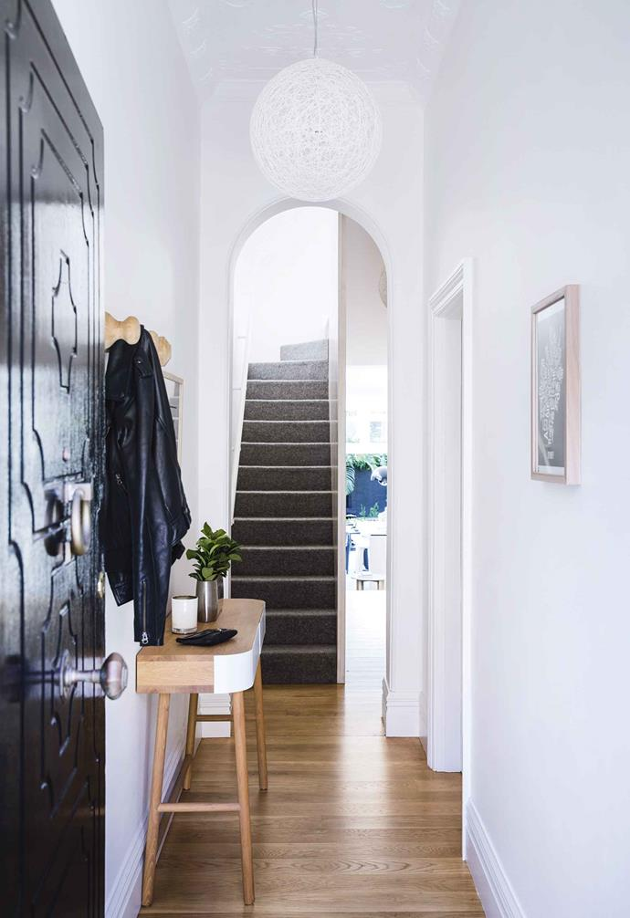 "A slimline hallway console and clever wall hooks provide ample storage in the entryway to this [relaxed light-filled terrace](https://www.homestolove.com.au/relaxed-terrace-paddington-18366|target=""_blank"")."