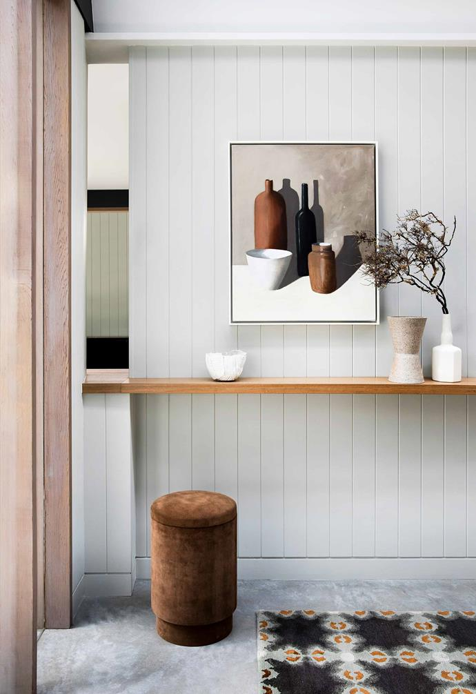 "This [nature-inspired home in Riverview](https://www.homestolove.com.au/nature-inspired-house-riverview-20198|target=""_blank"") features a sleek timber floating bench and velvet ottoman in the entryway."