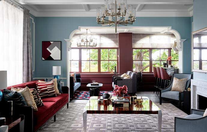 Kelly Wearstler for Visual Comfort 'Liaison 20' chandelier, Bloomingdales Lighting. Fallingwater print, sofas, side tables, coffee table, all Greg Natale. Cushions, Unique Fabrics and The Textile Company. Lake Como rug, Greg Natale for Designer Rugs. Porta Romana table lamp, available from South Pacific Fabrics.