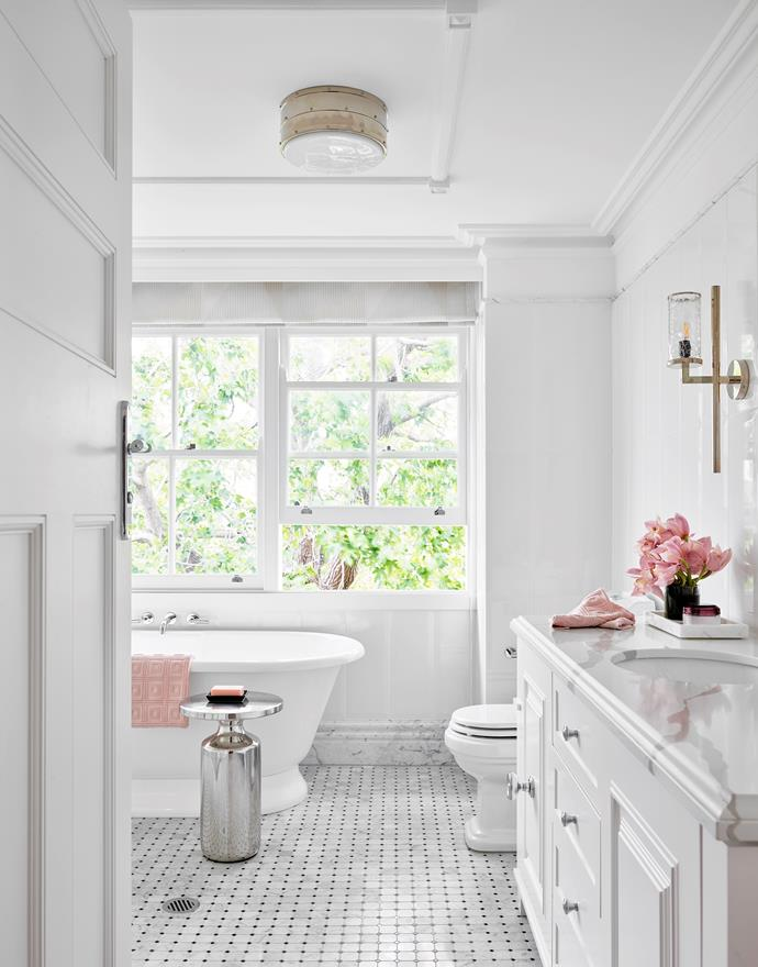 Kaldewei 'Vaio' bath, Reece. Custom vanity. Cheval side table, CB2. Carrara and Nero Marquina marble mosaic floor tiles, Teranova. Kelly Wearstler for Visual Comfort 'Liaison 1' sconce, Bloomingdales Lighting. For similar Ralph Lauren ceiling light, try The Montauk Lighting Co.