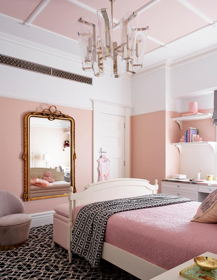 Aerin 'Alpine' chandelier, The Montauk Lighting Co. Doria slipper chair, James Said. The wall mirror is from the owners' existing collection. Walls and ceiling painted Dulux Basic Coral.