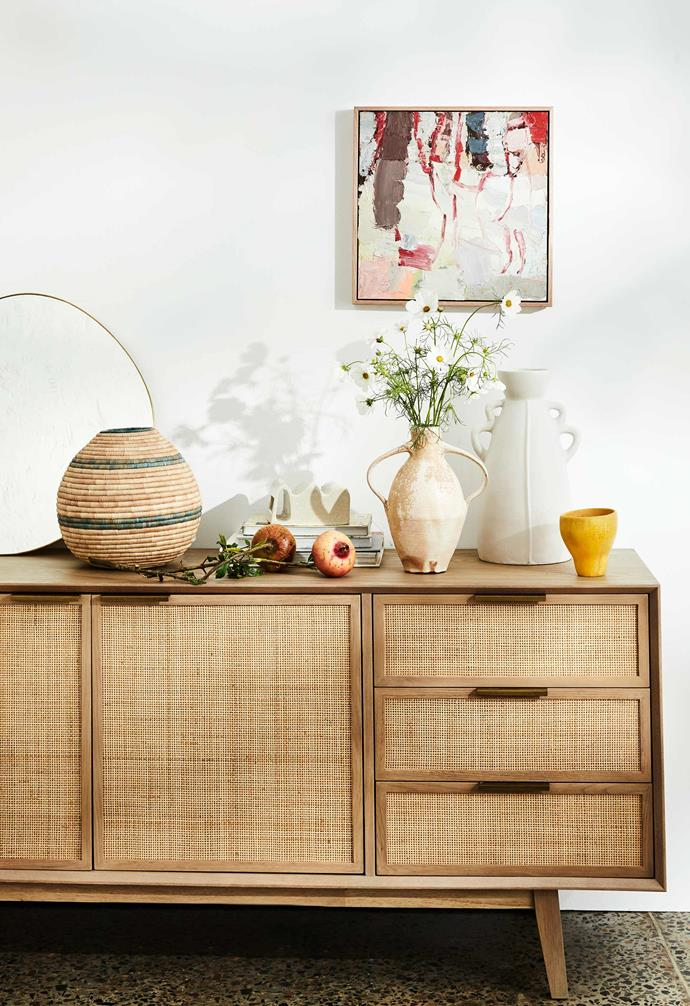 The rattan sideboard in this living area is a scene stealer in any room, providing ample style and extra storage space.