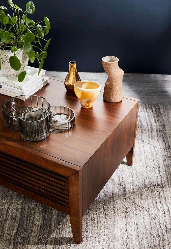 When it comes to decorative objects, don't be afraid to add unexpected materials and textures like fluted glass, matte ceramics and even glossy metallics.